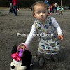 Harper Egglefield, 2, seems to have a preference for Minnie Mouse more than the Easter Bunny.<br /> ALVIN REINER/ P-R photo