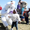 Roshelle Gray of Plattsburgh isn't quite sure what to think of the Easter bunny following a photo op with the big rabbit following the Easter egg hunt hosted by University of Vermont Health Network, Champlain Valley Physicians Hospital.<br /> GABE DICKENS/ P-R photo