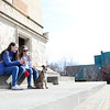 Beekmantown High School students Ireland Preston (left) and Bailee Whitney take a break from walking their new puppy to sit and enjoy the sunshine below the Macdonough Monument in downtown Plattsburgh. Schools around the North Country are closed this week for spring break.<br /> KAYLA BREEN/ Staff photo