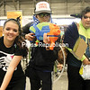 """Portraying characters from the video game Splatoon are (from left) Madison Cragle, Mario Collado and Cole Cragle of Peru. Cole, dressed as Agent 3, gave out free handmade versions of the """"Golden Toothpick,"""" which is presented to players in the game who defeat Agent 3.<br /> <br /> Ben Rowe/Staff Photo"""