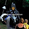 """The evil prince charges the audience during the Puppet People's rendition of """"The Last Dragon"""" at a recent performance at the Elizabethtown Social Center. Mike and Michelle Carrigan are the Puppet People.<br /> ALVIN REINER/ P-R photo"""