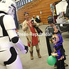 Miagh LaRock, 3, of Plattsburgh, dressed as Batgirl, chats with a stormtrooper from Star Wars Saturday at the 501st New England Garrison booth at Plattsburgh Comic Con. The Garrison, a chapter of the national 501st Legion Star Wars fan club, uses its costumes both to entertain fans and participate in charity events across New England.<br /> <br /> Ben Rowe/Staff Photo
