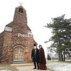 "Tim Palkovic (dressed as author Charles Dickens) and musical director Sue Carroll stand outside the Plattsburgh Memorial Chapel where their production of Dickens's ""A Christmas Carol"" will be staged this Friday.<br /> KAYLA BREEN/ STAFF PHOTO"
