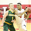 Plattsburgh State's (2) Chris Middleton looks to make a move on Oswego's Ian Schupp (1) during a SUNYAC men's basketball game Friday at Memorial Hall.<br /> KAYLA BREEN/ STAFF PHOTO