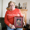 Jeannie Roberts, former director of the North County Chapter of the American Red Cross, sits inside her home in Plattsburgh while holding a framed photo taken during the 1998 Ice Storm of a tree coated in ice. Roberts said the beauty of that image gave her strength as she worked through the Ice Storm relief effort.<br /> KAYLA BREEN/ STAFF PHOTO