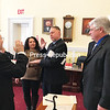 Wilmington Supervisor Randy Preston is sworn in as chairman of the Essex County Board of Supervisors by County Clerk Joseph Provoncha on Tuesday. Preston's wife, Michelle, holds the Bible for the ceremony as Vice Chair Shaun Gillilland (R-Willsboro) looks on.<br /> DENISE A. RAYMO/ STAFF PHOTO