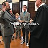 Justus Martin is sworn in as supervisor of the Town of Moira Wednesday by Franklin County Court Judge Robert G. Main Jr. Holding the Bible is his son, Josiah, while younger son Jonathan and his wife, Martha, look on. Not pictured, but with their dad, were his daughters Melody and Charisa and his youngest son, Asher.<br /> DENISE A. RAYMO/ STAFF PHOTO