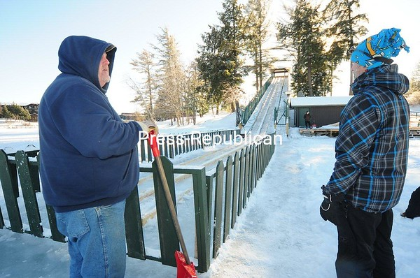 Willis Clark (left) of the North Elba Park District Maintenance Department talks with a visitor to Lake Placid about the new 200-foot-long toboggan chute. Although the venue was completed in 2017, unusually warm weather last winter resulted in little use of the ice chute. The previous toboggan run was in the same downtown location but was recently torn down after serving the community for about a half century. The new facility was built by Jeffords Steel of Plattsburgh and will operate noon to 4 p.m. Saturday to Monday and noon to 4 p.m. and 7 to 9 p.m. Tuesday through Friday. JACK LADUKE/ P-R PHOTO