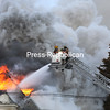 Smoke billows out of the flame-engulfed third floor as firefighters try to control the blaze.<br /> KAYLA BREEN/ STAFF PHOTO