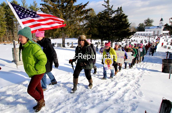 Participants in Saturday's Adirondack Women's March climb the long hill to Inez Milholland's gravesite in the First Congregational Church of Lewis Cemetery. ALVIN REINER/ P-R PHOTOS