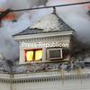 Orange flames flash through a small window on the third floor of the Brinkerhoff Street home.<br /> KAYLA BREEN/ STAFF PHOTO