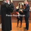 Beekmantown Town Justice Brendan Dupree takes the oath of office from his boss, Franklin County Court, Supreme Court and Surrogate Court Judge Robert G. Main Jr. Dupree, who is an associate court attorney for Main, was accompanied by his wife, Erica, and their son, Thomas.<br /> DENISE A. RAYMO/ STAFF PHOTO