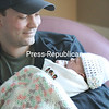 Vern Witherbee cradles his newborn daughter, Skylar Rose, Monday afternoon at University of Vermont Health Network, Champlain Valley Physicians Hospital, in Plattsburgh. Skylar came into the world at 12:51 a.m. New Year's Day, weighing 7 pounds, 8 ounces. She is the daughter of Witherbee and Michelle Cutter.<br /> KAYLA BREEN/STAFF PHOTO