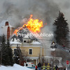Flames engulf the roof and third floor and attic area of the historic house at 72 Brinkerhoff in Plattsburgh Friday as fire crews from stations 1 and 2 of the Plattsburgh City Fire Department attempt to control the blaze. The five-bedroom home was being rented by a SUNY Plattsburgh fraternity; no one was there when the fire erupted.<br /> KAYLA BREEN/ STAFF PHOTO