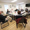 Champlain Valley Family Center for Drug Treatment and Youth Services Inc. staff have a meeting inside one of five meeting rooms in the newly renovated facility at 18 Ampersand Drive in the Town of Plattsburgh, the former space of Clinton County Mental Health and Addiction Services. With more space and staff, the center can get patients into treatment more quickly and better help them reach recovery.<br /> KAYLA BREEN/ STAFF PHOTO
