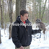 At Adirondack Wildlife Refuge in Wilmington, Keith Ahrens holds an injured barred owl named Jasper that had been hit by a car and broke a wing. Ahrens, who works at the refuge, suggested that people should not throw food out on the road because while small rodents will eat the trash, owls focus only on their prey and will not see the approaching vehicles and so can be struck. The Wildlife Refuge includes a 1-mile educational hiking trail and enclosures that hold raptors, including hawks, owls and eagles; and coyotes and wolves. The public is always welcome.<br /> JOANNE KENNEDY/ P-R PHOTO