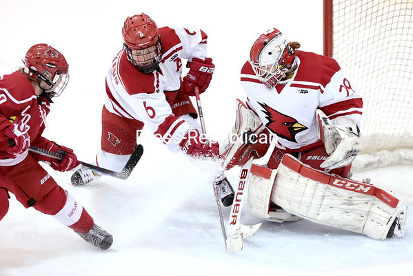 Plattsburgh State goaltender Kassi Abbott makes a save on a shot off a rebound by Cortland's Kirsten MacDowell, while teammate Maci Hoskins provides support, during a Northeast Women's Hockey League game Saturday at Stafford Ice Arena. GABE DICKENS/ P-R PHOTO