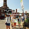 Protesters march with signs held high in Saranac Lake. They joined demonstrators at more than 700 marches and rallies across the nation, all in opposition to the Trump administration's immigration policies.<br /> JACK LADUKE/ P-R photo