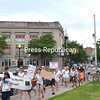 "Hundreds of marchers stream down Margaret Street as part of Saturday's ""Families Belong Together"" protest in Plattsburgh, voicing their opposition to the Trump administration's immigration policies.<br /> BEN WATSON/ P-R photo"