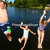 Celebrating summer in the cool waters of Lake Colby are Jack La Quay, Madelyn Frochette and Charlotte La Quay (from left). This week's blistering heat wave will make that cool water even more attractive.<br /> JACK LADUKE/ P-R photo
