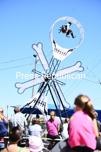 """Spectators watch in awe as performers dressed head to toe in pirate costumes jump and somersault to keep the """"Wheel of Destiny"""" spinning during the Pirates of the Colombian Caribbean aerial high wire show at the 70th-annual Clinton County Fair in Morrisonville. The performers entertained families with sword fights, acrobatics and tricks on a thin wire cable 30 feet above a giant pirate ship.Those who missed the show can catch it at 2:30 and 7:15 today, with other performances slated for Friday, Saturday and Sunday, too. KAYLA BREEN/ STAFF PHOTO"""