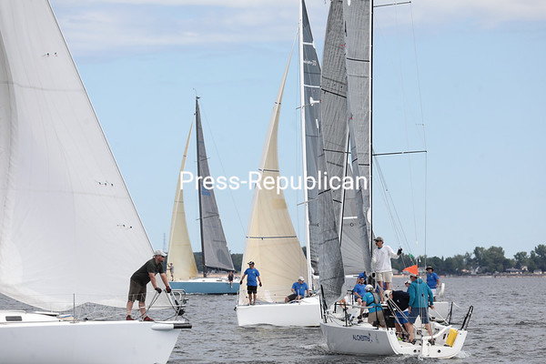Sailboats and their crews circle around the starting line in Plattsburgh Bay while waiting for the horn to signify the start of their class race during the 41st-annual Mayor's Cup Regatta on Lake Champlain Saturday morning. About 75 vessels across three divisions competed in the regatta — the largest on Lake Champlain — with the awards ceremony at the Naked Turtle afterwards. John Touron, of Waterbury Center, Vt., took home first prize in the regatta race aboard his ship, Dunder. GABE DICKENS/ P-R photo