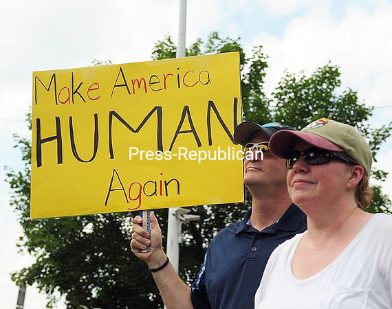"John and Kathy Stack of Saranac Lake at the ""Families Belong Together"" rally Saturday in Saranac Lake. About 250 people turned out for the march and rally there.<br /> JACK LADUKE/ P-R photo"