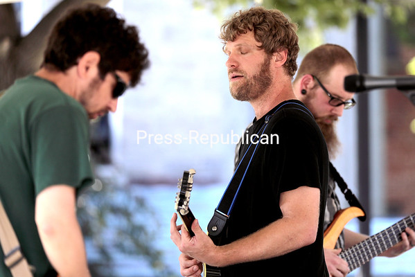 The band Finkle and Einhorn jam in Trinity Park Saturday afternoon as a part of the Mayor's Cup festivities. Performances also included Alexis P. Suter Band and Scott Sharrad at the Macdonough Park bandshell.<br /> GABE DICKENS/ P-R photos