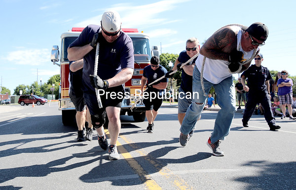 The Plattsburgh City Police Department team competes in the third-annual firetruck pull in front of City Hall Saturday morning. GABE DICKENS/ P-R photo