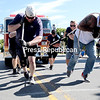 The Plattsburgh City Police Department team competes in the third-annual firetruck pull in front of City Hall Saturday morning.<br /> GABE DICKENS/ P-R photo