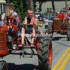 A group of tractors reminds parade-goers of the importance of agriculture in Essex County in the Fourth of July parade in Essex.<br /> ALVIN REINER/ P-R PHOTO