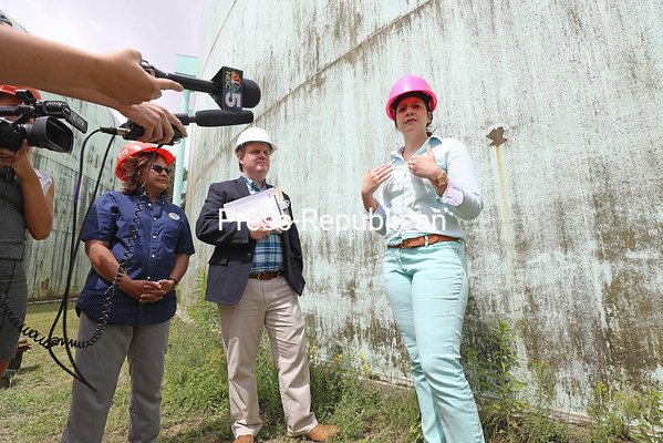 """Congresswoman Elise Stefanik speaks to the media during a tour Friday of the Water Tank Farm at the end of Kimberly Lane in Morrisonville with Town of Plattsburgh Supervisor Michael Cashman (center) and Town Councilor Barb Hebert (left). With Stefanik's encouragement and a letter of support, the Town of Plattsburgh applied for (and won) a $500,000 Economic and Infrastructure Development Investment Program grant from Northern Border Regional Commission for the installation of two 12-inch water production wells and construction of a treatment building for fluoridation and chlorination at the location. """"We really prioritized this project,"""" Stefanik said. """"This is an example of a win for this district and a win for infrastructure. It's so critical, not just to Plattsburgh, but to the broader Clinton County, to the broader economy."""" The town also provides water to the towns of Schuyler Falls and Beekmantown. KAYLA BREEN/ Staff photo"""