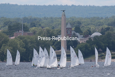 More than 30 Thistle-class sailboats, which are 17-foot sailing dinghies of the same design and featuring a crew of three, compete in the Atlantic Coast Championships on Lake Champlain alongside the regatta. Racing is also taking place throughout the morning and afternoon today. GABE DICKENS/ P-R photos