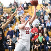 Moriah's Jay Strieble (33) goes up for a layup as Keene's Miles Warner (15) defends during a Section VII Class D boys basketball semifinal Wednesday in Clintonville.<br /> KAYLA BREEN/ STAFF PHOTOS