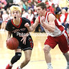 Crown Point's Hunter Pertak (11) looks to dish out a pass with Schroon Lake's Collin Bresnahan (10) defending.<br /> KAYLA BREEN/ STAFF PHOTO
