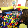 """SUNY Plattsburgh students (from left) Emily Patenaude and Cheryth Youngmann interview each other with their instructor Kate Mulhollem while sitting in a ball pit at the Angell College Center. The """"Strangers in a Ball Pit"""" activity encourages strangers and friends to talk about different topics in their lives. The activity is part of a week-long diversity event at the college that celebrates diversity through a broad range of social gatherings, events and learning sessions.<br /> KAYLA BREEN/ STAFF PHOTO"""