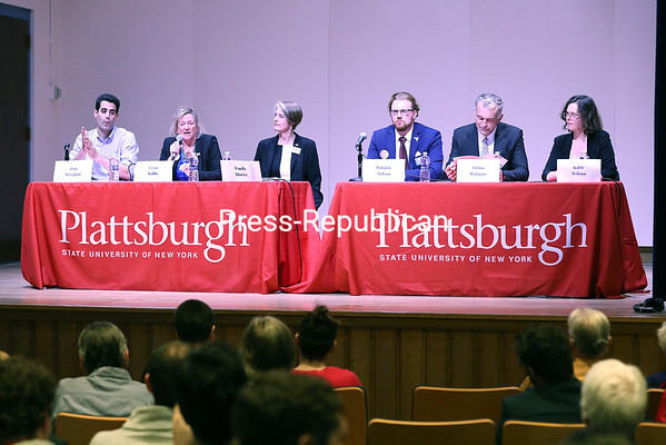 Candidates looking to run for the 21st Congressional District seat against incumbent Elise Stefanik Don Boyajian (from left), Lynn Kahn, Emily Martz, Patrick Nelson, Dylan Ratigan and Katie Wilson speak at a forum held at SUNY Plattsburgh Friday evening. KAYLA BREEN/ Staff photo