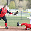 Beekmantown's Bailey Carter prepares to catch the ball at second base as Saranac's Chelsea Trombley looks to slide in safely during a Champlain Valley Athletic Conference softball game Monday in Saranac.<br /> KAYLA BREEN/ STAFF PHOTO