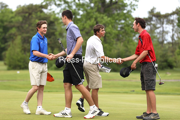 Willsboro's Paul Fine-Lease (left) congratulates Moriah's Joey Stahl, and Northeastern Clinton's Anthony Barcomb (right) shakes hands with Lake Placid's Drew Maiorca after the foursome completed the 18th hole. KAYLA BREEN/ STAFF PHOTO