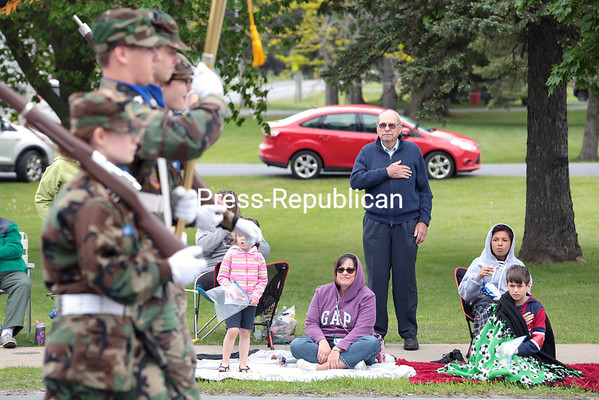 A man stands at attention as the Civil Air Patrol James P. O'Connor Composite Squadron of the United States Air Force Auxiliary Color Guard marches in the Chazy Memorial Day Parade on Sunday afternoon. GABE DICKENS/ P-R photo
