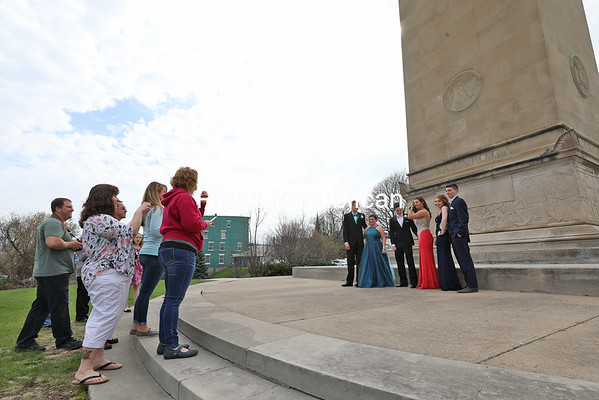Northern Adirondack Central School students pose for prom pictures as their parents get cameras ready at the MacDonough Monument in downtown Plattsburgh. With prom and graduation season's arrival, students are reminded to be safe on the roads. KAYLA BREEN/