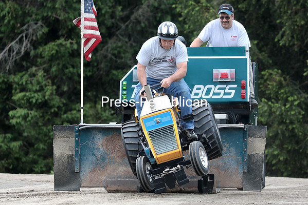 Michael Hurteau of Brushton gets airborne on his modified tractor during a tractor pull competition at the St. Mary's Church grounds in Champlain as a part of Memorial Day festivities. Using too high a gear caused the front end to lurch upwards at the start, bucking the counterweights and sending them under the rear wheels. GABE DICKENS/ P-R photo