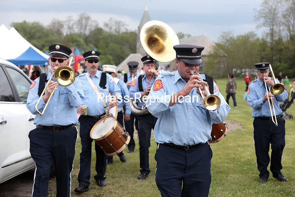 Members of the Norwood Fire Department band perform one last song as they make their way to the parking lot during Sunday's Memorial Day festivities in Champlain. GABE DICKENS/ P-R photo