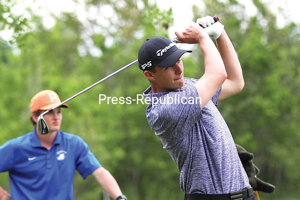 Moriah's Joey Stahl watches a tee shot during the second day of the Section VII golf tournament Friday at North Country Golf Club. Stahl captured the Section VII individual title, turning in a 3-over-par 70-77-147. KAYLA BREEN/ STAFF PHOTO