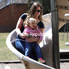 One-year-old Alivia McKee smiles as she glides down the slide with her mother, Rissa Gagnier, at Melissa L. Penfield Park in Plattsburgh.<br /> KAYLA BREEN/ Staff photo