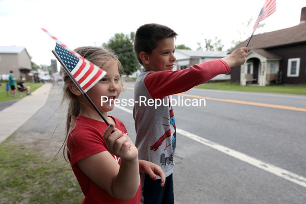Keira Monette, 5, and her 7-year-old brother, Brodi, of Cumberland Head, proudly wave the stars and stripes during Sunday's the Memorial Day Parade in Chazy. GABE DICKENS/ P-R photo