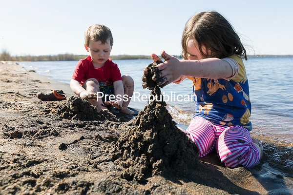 Dean, 3, and Renee Grigorenko, 4, of Peru play on the shores of Lake Champlain at AuSable Point State Park in Peru during a warm spring afternoon. Their family, including mother and father Mariah and Dale, have taken full advantage of the warm weather by making frequent stops at the park for various activities, such as having a picnic and fishing. The Grigorenkos moved to Peru from Corinth, Miss., so Dale could start a new job in the area. GABE DICKENS/ P-R photo