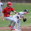 Moriah's Connor Anderson lunges to first base as AuSable Valley's Mason Dubay secures the ball in his glove for an out.<br /> KAYLA BREEN/ STAFF PHOTO