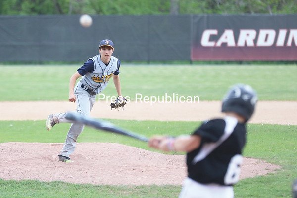 Crown Point's Tristan Carey hits a pitch from Lake Placid's Jesse Izzo back up the middle during the Section VII Class D baseball championship Friday at Chip Cummings Field. KAYLA BREEN/ STAFF PHOTO