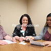 From left, Cancer Services Program of Clinton County Screening Coordinator Didi Remchuk, Targeted Outreach's Christina Porter and Data Manager Adele Aarathi go over a colon screening kit at the Champlain Valley Open MRI in Plattsburgh.<br /> KAYLA BREEN/ Staff photo